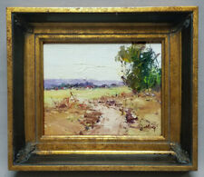 Framed oil painting of impressionistic landscape with heavy wood frame