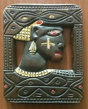 AN AFRICAN HAND CARVED WALL PANEL.