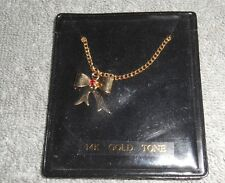 VINTAGE - 14K GOLD TONED NECKLACE WITH BOW AND RED STONE - KOREA