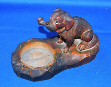 An attractive Victorian Continental carved wooden dog with pipe desk or pin tray