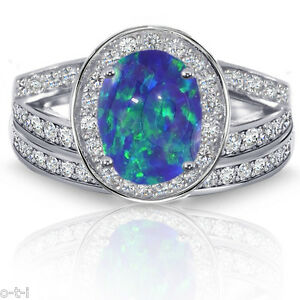 Large Dark Blue Fire Opal Oval Halo Engagement Clear CZ Silver Ring Set