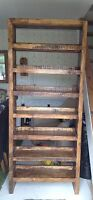 A tall wooden hand-crafted  display unit/shoe rack