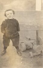Young Boy Smoking Cigarette with Toy Engine Vintage Real Photo Postcard (198RP)