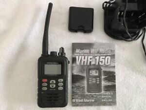 WEST MARINE VHF 150 MARINE RADIO with charger and owners manual. BOATING