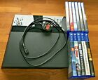 PS4 CONSOLE AND 11 GAMES