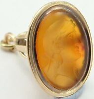 Antique 9ct yellow gold watch fob pendant seal set with a carved intaglio stone.