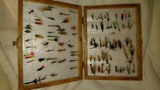 compact vintage wooden box containing various fishing flies