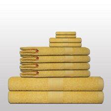Serviettes, draps et gants de salle de bain classiques jaunes