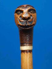 jolie canne ancienne en bambou à tête grottesque