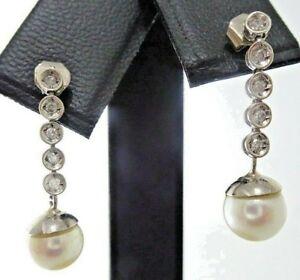 Pendientes de oro blanco con 10 diamantes y perla natural