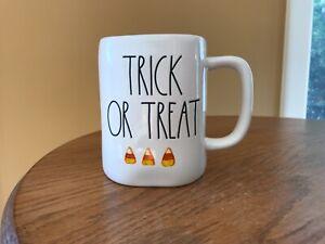 "Rae Dunn Halloween ""trick or treat"" orange/white candy corn mug NEW"