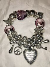 Handcrafted metal bracelet elasticated with charms glass Beads good condition