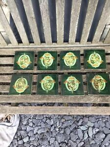 8 FIREPLACE ? TILES Flower Shield shape green yellow brown