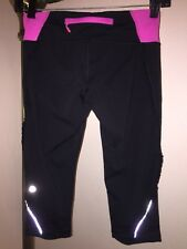 LULULEMON Run Fast Free Crop Capri Sz 4 Black/Pink Tiny Ruffle Down Leg