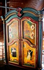 Vintage armoire hand painted using chalk paint using different colors.