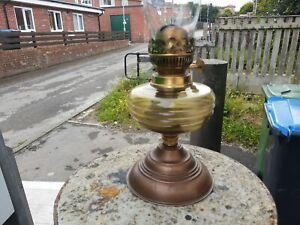 vintage oil lamp. Cast iron pyramid base, blue fluted glass reservoir, chimney.