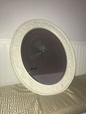 White Round Mirror with decorative frame. About medium sized.