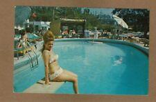 North Miami Beach,Florida FL Sunny Isle Motel Court, (Lady, NOT GETTING WET)