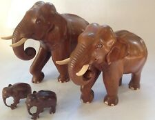 4 beautiful vintage carved wood elephant family - cigarette dispensers