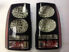 GENUINE VALEO 2014 DISCOVERY 3/4  PAIR OF BLACK SURROUND LED REAR LAMPS NEW