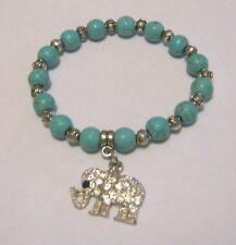 Great elasticated beaded bracelet silver turquoise elephant charm white stones
