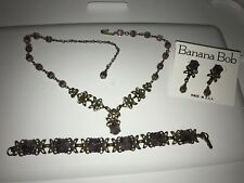 Rare Banana Bob purple crystal necklace, bracelet and earrings