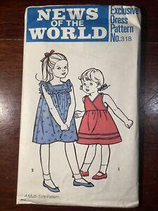 New Vintage NEWS OF THE WORLD Child's Dress Pattern 318 Size 2/3 - 5/6yrs Uncut