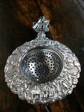 VINTAGE SILVER TONE METAL TEA STRAINER~DECORATIVE WITH FLOWERS SHIPS & WINDMILLS