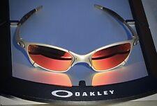 Oakley X-metal Juliet titanium with fire custom cut torch red lenses.
