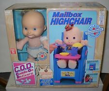 #5112 NRFB TYCO C.O.D. Cuddle On Delivery Doll with Mailbox Highchair