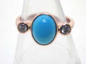 Turquoise diamond and 9 carat rose gold trilogy ring size N 2.9 grams