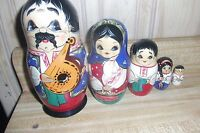 Wooden Nesting Dolls 5 pieces,  black/blue/red theme, very good condition.