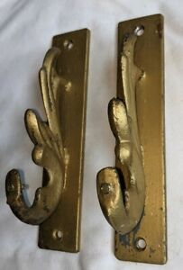 (2) ANTIQUE Vintage GOLD Cast Iron ART DECO Coat Hooks ? Curtain Rod Holders ?