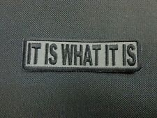 IT IS WHAT IT IS EMBROIDERED PATCH DARK GRAY BACKING FUNNY SAYING