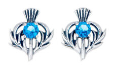 Sterling Silver Thistle Stud Earrings With a Decemberf Birthstone Centre