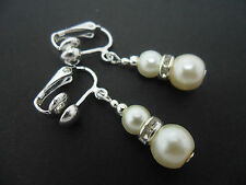 A PAIR OF SHORT DANGLY IVORY GLASS PEARL  SILVER PLATED CLIP ON   EARRINGS.