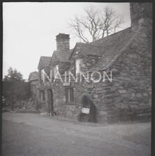 Original photo negative -Coracle outside very old building - poss museum or shop