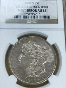 1897 S S$1 Obverse Struck Thru Mint Error AU58