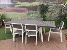 Set Harmony in Resina composto da tavolo allungabile e 6 poltrone finto legno.
