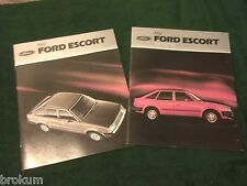 "2 DIFFERENT MINT ORIGINAL 1982 FORD ESCORT SALES BROCHURE 11"" X 9"" (BOX 747)"