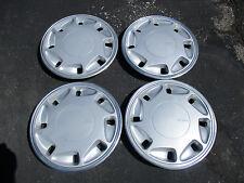 Genuine 1988 to 1991 Dodge Spirit Shadow Daytona 14 inch hubcaps wheel covers