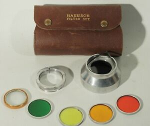 VINTAGE HARRISON GLASS FILTER SET IN LEATHER CASE WITH 50MM ADAPTER 30MM FILTERS