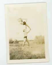 Vintage snapshot sports photo  Man and woman in graceful   gymnastic pose