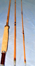 A rebuilt South Bend 9 ft 3 piece bamboo fly rod with rainbow wrap