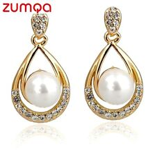 Ocean Pearl Teardrop Studded Earrings by ZUMQA