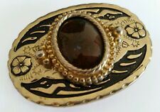 Black and Gold Cowboy Belt Buckle With Dark Red Accent Stone