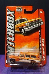 Matchbox  MBX HEROIC RESCUE 1963 CADILLAC AMBULANCE in Orange. Long card. VHTF