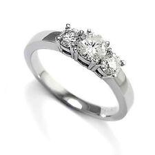 Engagement Ring 4 to 9 # R1204. 950 Platinum .90cwt. H-I1 Diamond Three Stone