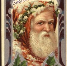 RARE..!  FATHER CHRISTMAS WEARS PINE GARLAND,CINNAMON,BROWN ROBE,SANTA POSTCARD