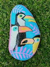 Hand painted pebble Colourful tropical toucans and pink jungle leaves